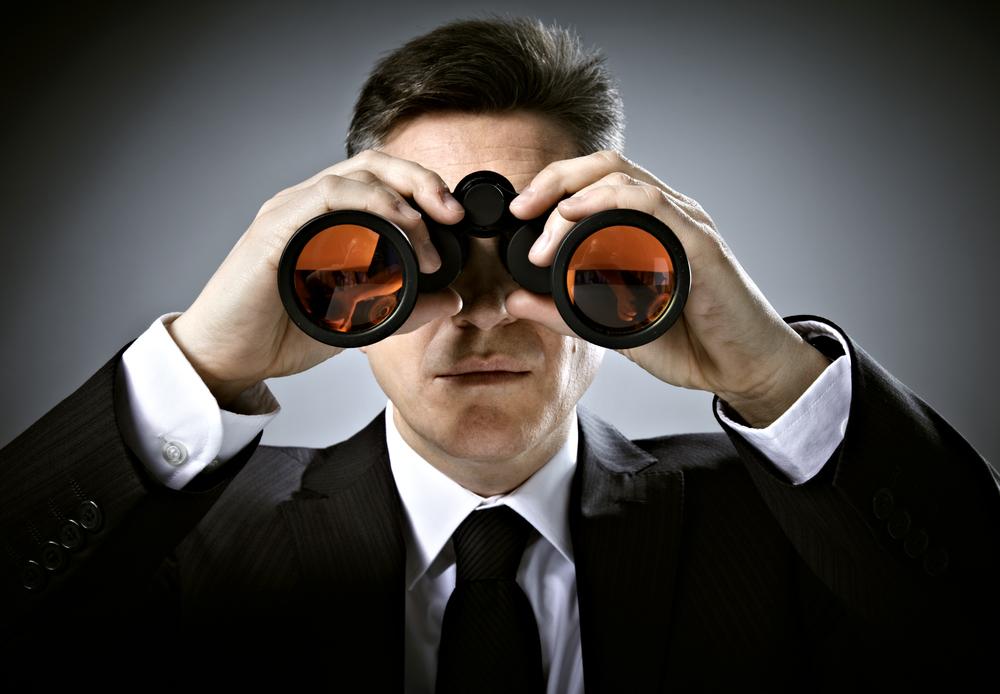 man-in-suit-with-binoculars.jpg