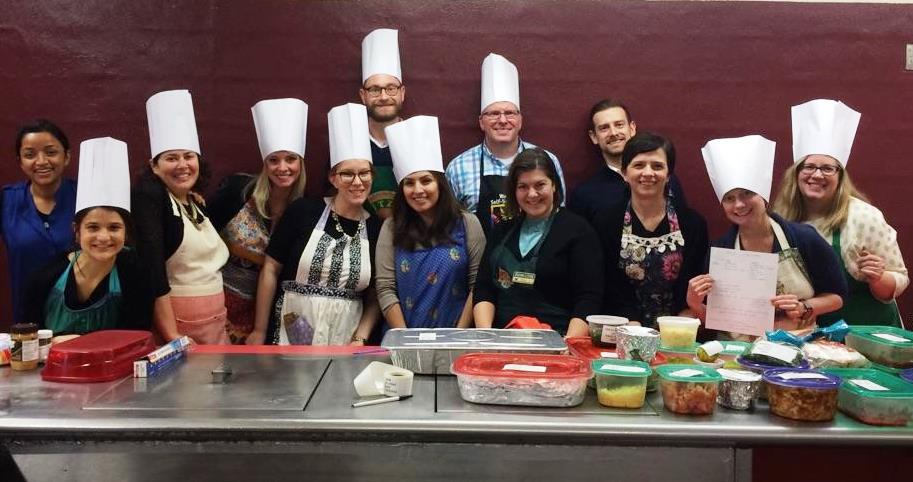 Happy group from Nestle Waters North America making dinner for youth in our Residential program.
