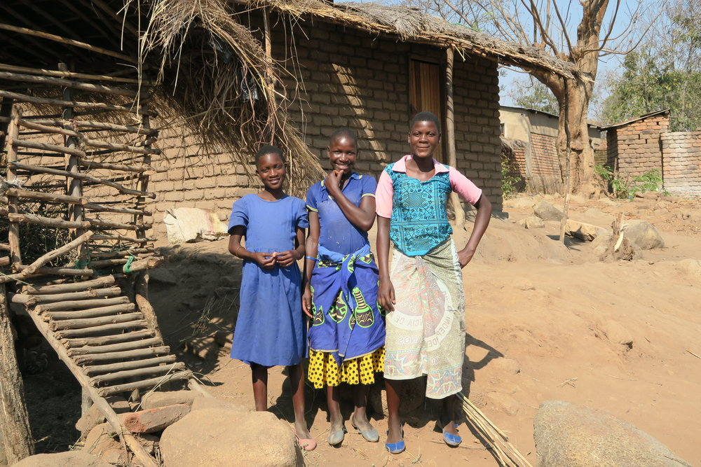Pauline (18), Eve (15), and Freda (10) - The girls were left living alone when both of their parents passed away. Pauline, who was only 15 at the time, became the head of their household and took on the responsibility of caring for her younger sisters. With no income or support network, the girls were often going hungry and had dropped out of school.Whilst attending one of WeSee Hope's local Kids' Club, which provides a safe place for vulnerable children to learn, play and socialise, a trained volunteer found Pauline looking alone and afraid - she was worried about not having enough food for her sisters and was in need of help.The volunteers visited the girls at home regularly, creating a vital support system to ensure they had enough food, clothes and protection. Pauline was given a bicycle to help her to earn an income, some goats to provide milk and kids, and a garden to grow produce. Together, the Kids' Club and the community came together to care for them and since then the girls have been eating three meals a day and Eve and Freda are back in school.