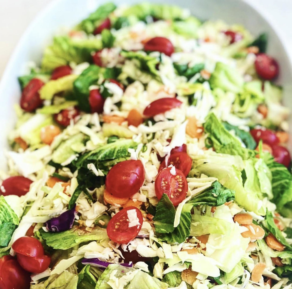 "garbage salad  - this weeks ""ready for the weekend salad"" {aka a garbage salad made up of leftovers on a friday} features: romaine, baby tomatoes, cabbage, carrots & green onions - xoxjackie"