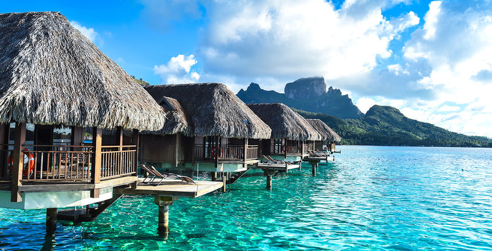 Tahiti - Tahiti: just the word conjures up centuries' worth of images: hibiscus flowers; bronzed dancers in grass skirts; a humid breeze over turquoise sea. The islands of French Polynesia became legends the minute the first European explorers reached their home shores with tales of a heaven on earth where the soil was fertile, life was simple and lust was guilt-free. While the lingering hype is outdated, French Polynesia is still about as dreamy as reality gets. The lagoons are just as blue but there are freeways, more conservative values and nine-to-five jobs. It's not the untainted paradise of explorer lore, but at least there's an internet connection.