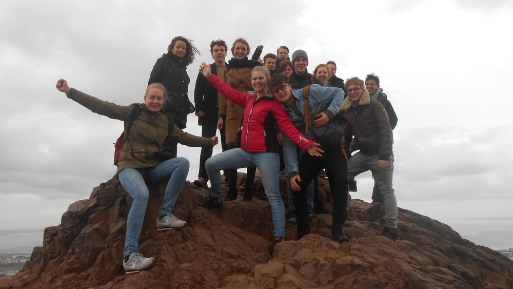 Foreign Trip - Photo: Group photo on top of Arthur's Seat in Edinburgh, Scotland..