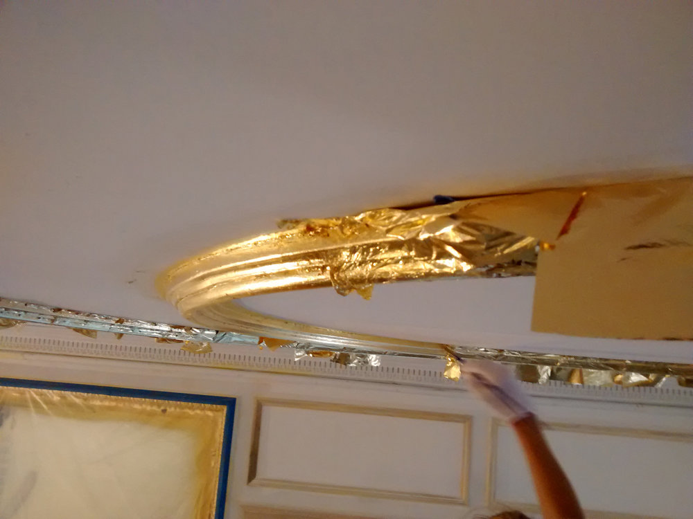 Crown and ceiling molding in gold leaf.