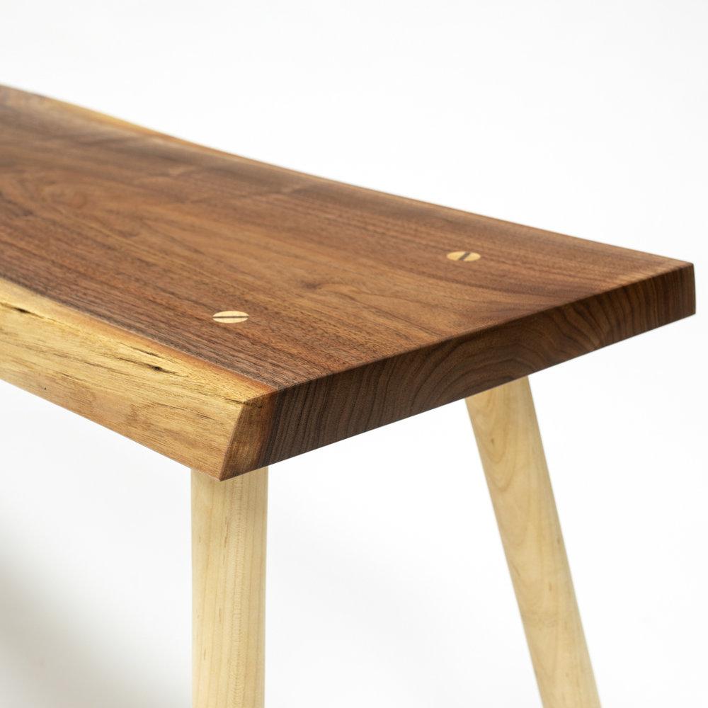 Walnut bench through tenon detail