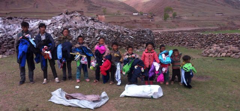 Children in a Martsang Kagyu international supported warm winter clothes