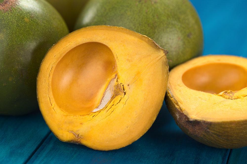 photo of lucuma fruit sliced in half