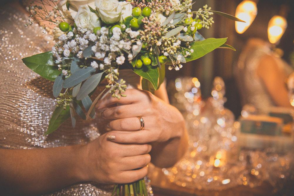 Bouquet + ring = wedding accomplished!