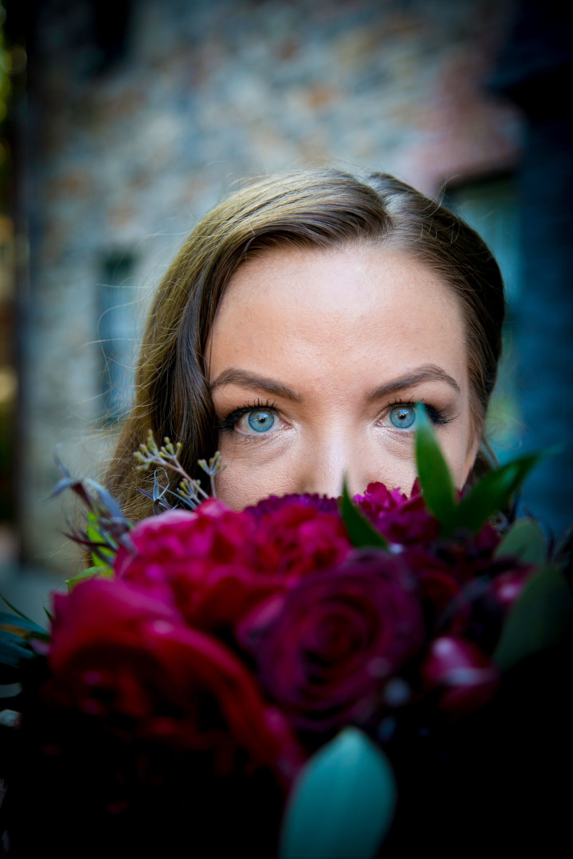 Jayme behind her bouquet.