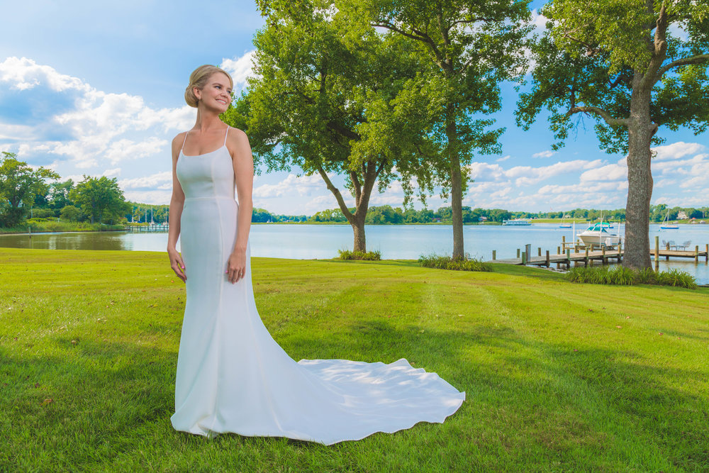 Bride outdoors by water