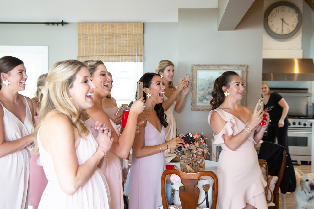 Bridesmaids taking pictures