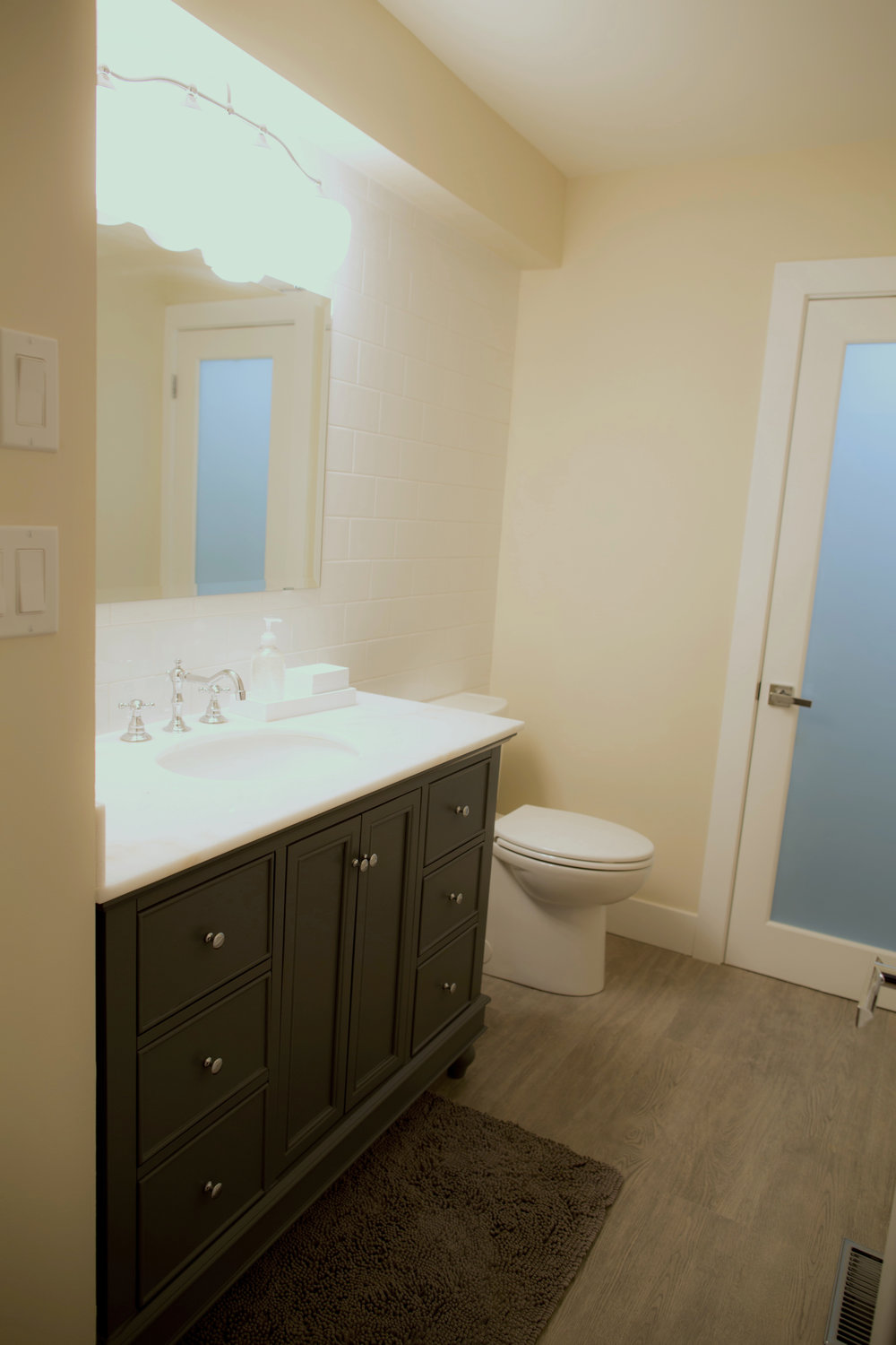 Main bathroom - Elegant vanity, subway tile backsplash and a new lease on life.