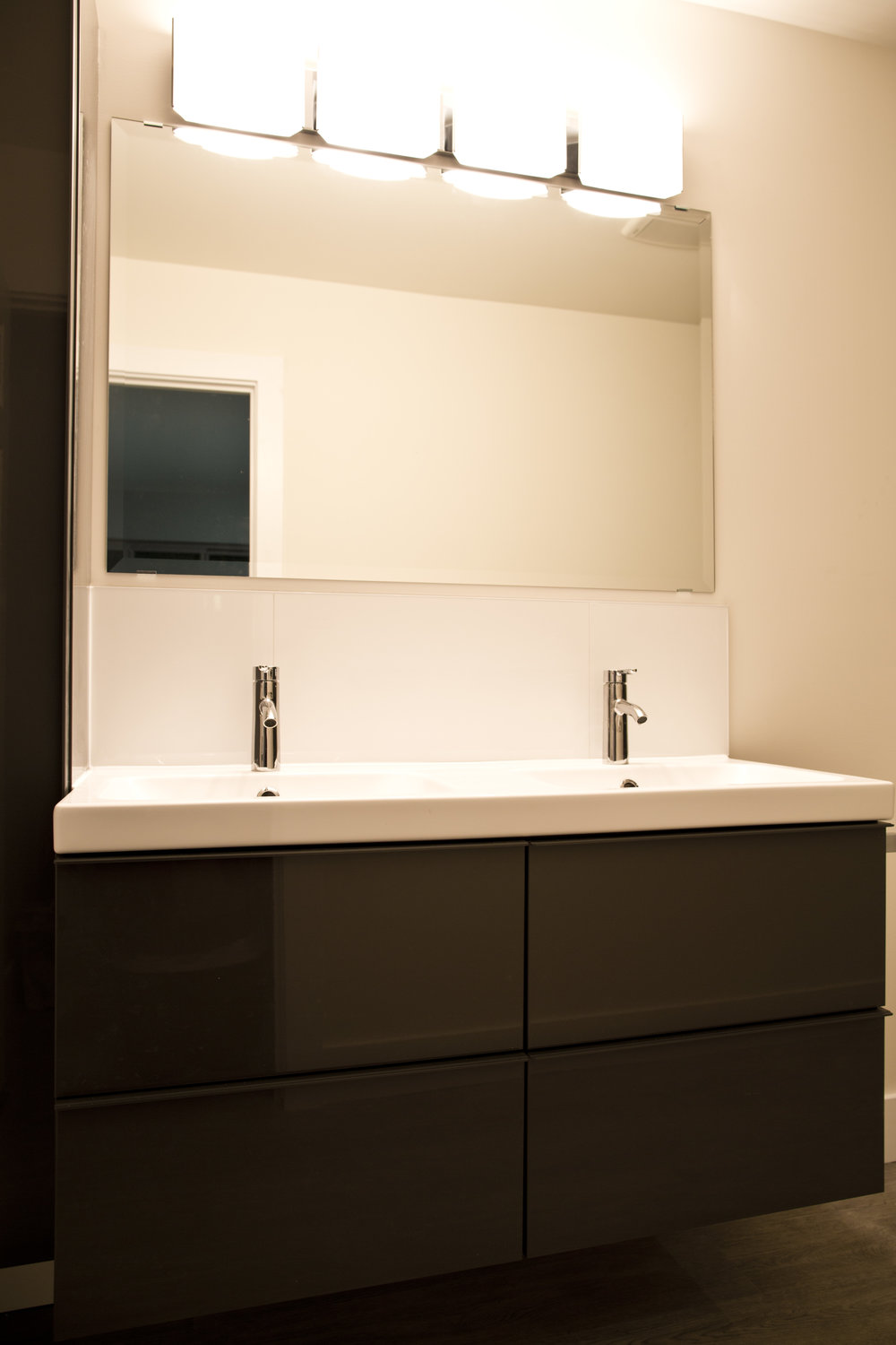 Master Bathroom - Clean lines and high contrast, modern cabinets create a stunning space.