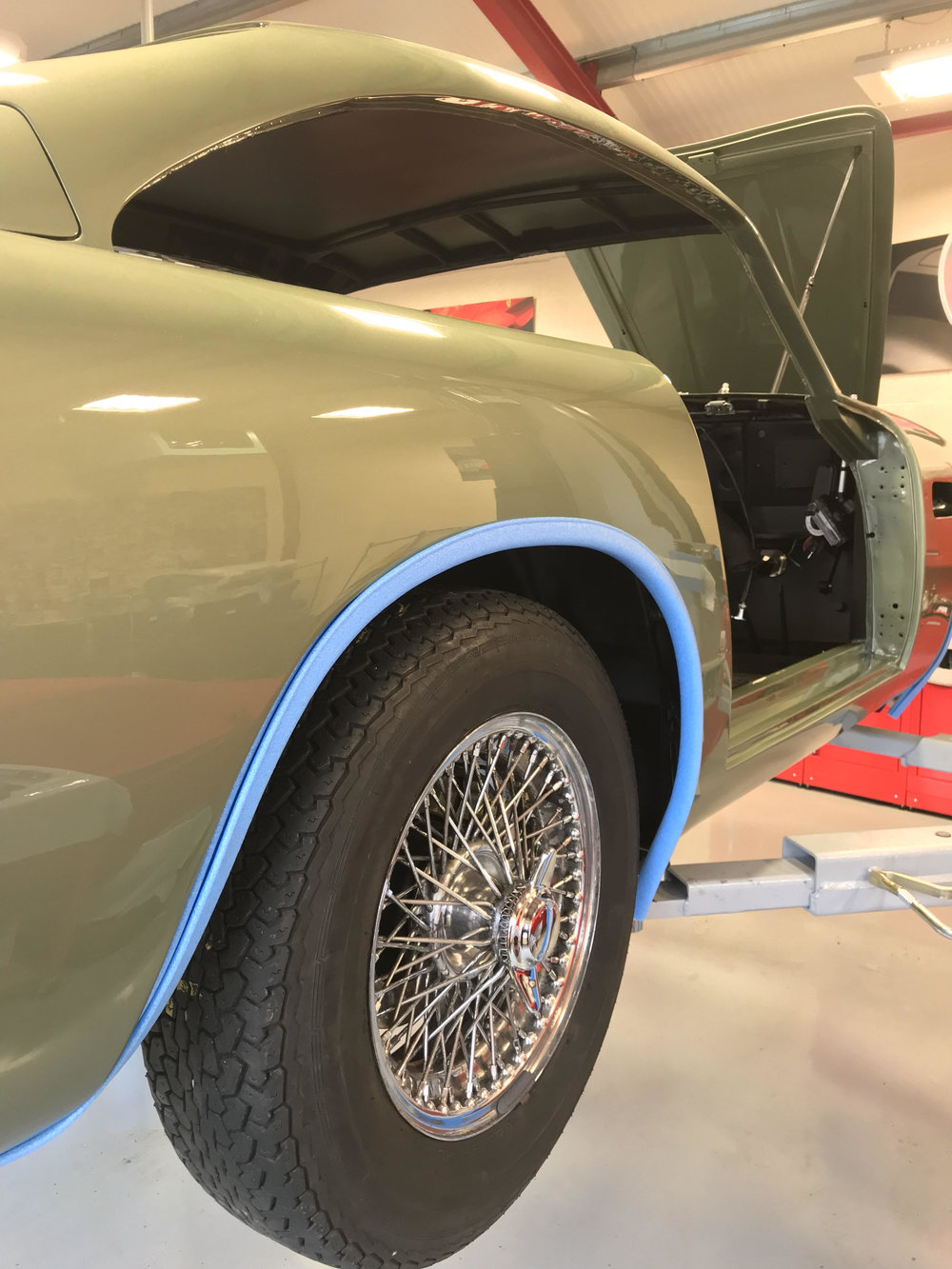 With all the suspension, brake pipes and numerous other items in place our Aston Martin DB5 is coming along nicely. With a wonderful paint job it certainly stands out in a workshop full of Ferraris.