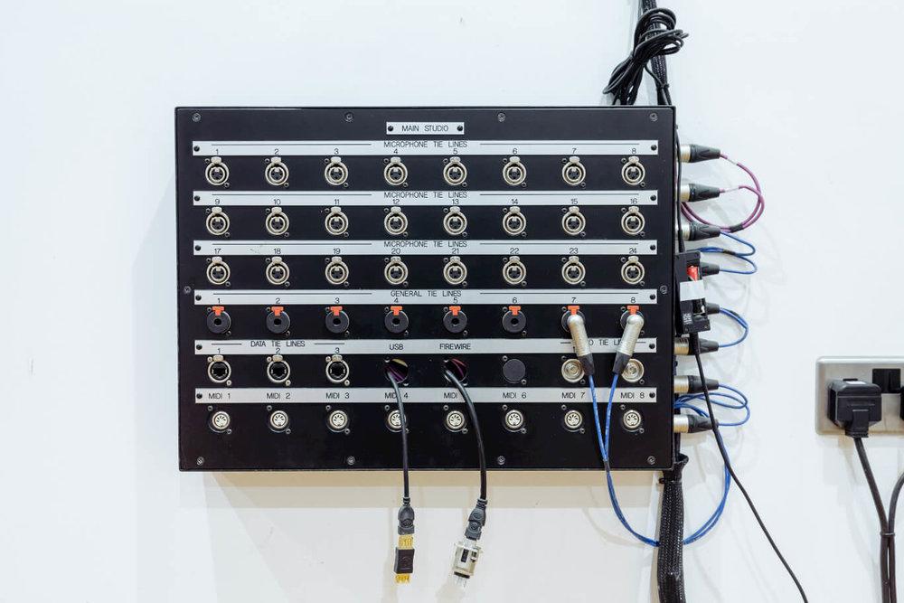 patchbay-on-wall-evolution-recording-studios-oxford.jpg