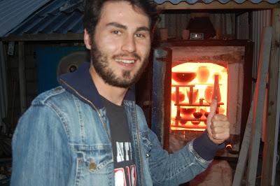 Metin Erturk opening the kiln