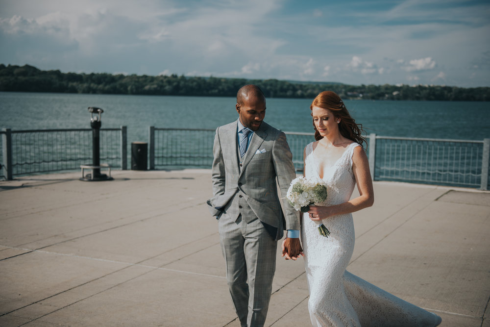 bride-groom-on-boardwalk-toronto-outdoor-summer-wedding-documentary-wedding-photography-by-willow-birch-photo.jpg