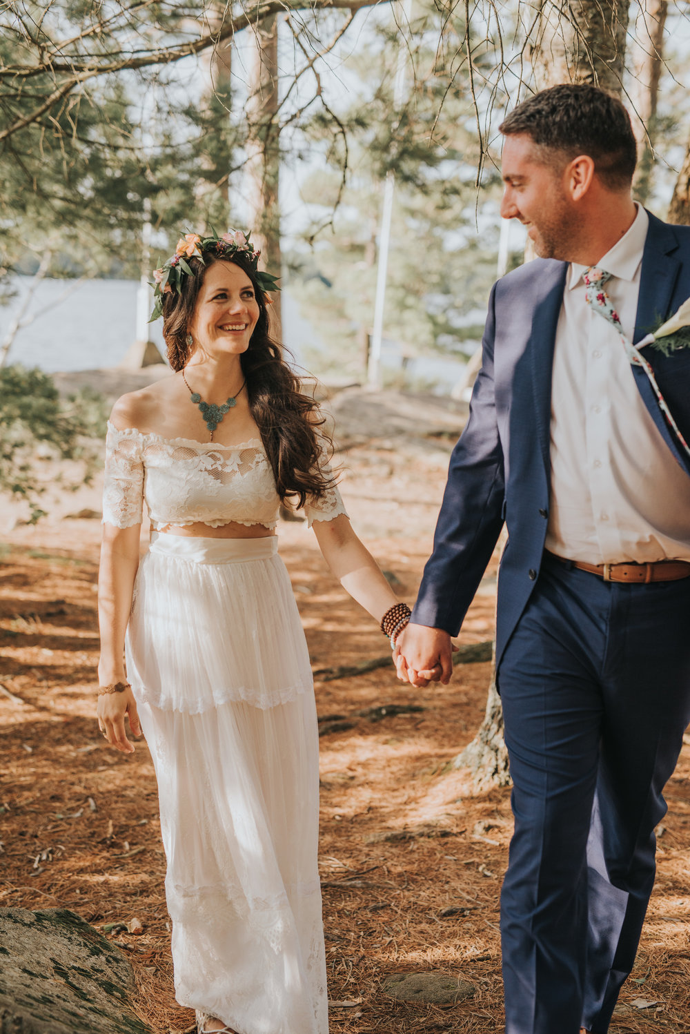 bride-groom-holding-hands-rustic-cabin-toronto-bohemian-boho-outdoor-summer-wedding-documentary-wedding-photography-by-willow-birch-photo.jpg