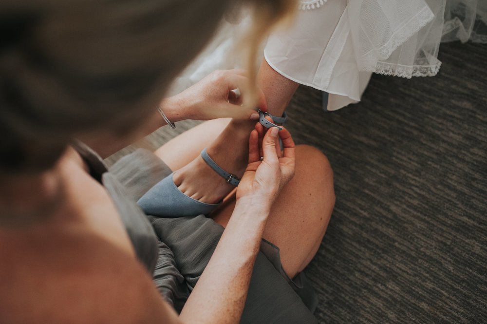 getting-ready-pictures-wedding-shoes-toronto-same-sex-wedding-willow-and-birch-photography-documentary-wedding-photographers.jpg