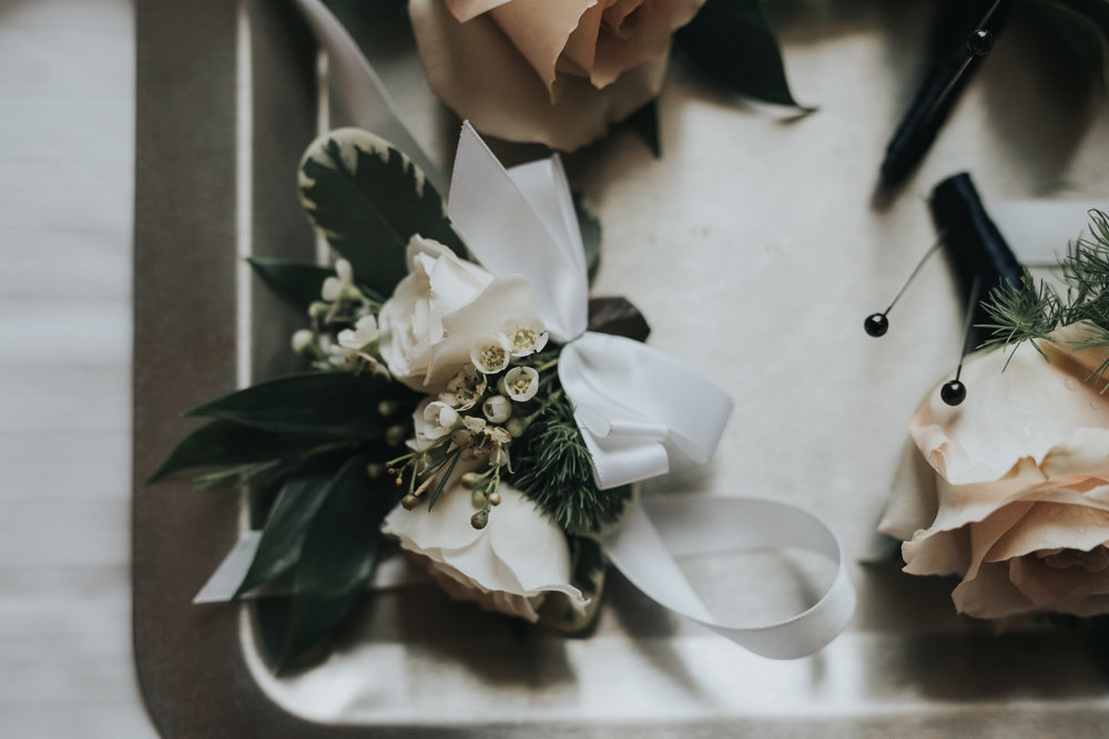 wedding-florals-boutonniere-toronto-same-sex-wedding-willow-and-birch-photography-documentary-wedding-photographers.jpg