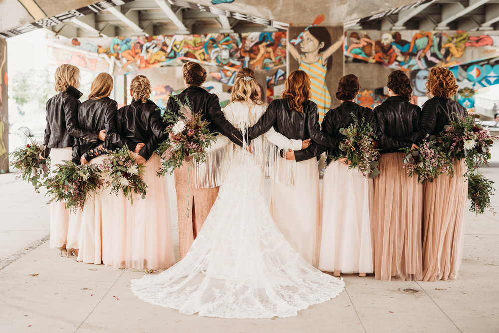 bridal-party-leather-jacket-picture-underpass-park-toronto-rustic-boho-airship37-wedding-by-willow-birch-photo-toronto-documentary-wedding-photographers.jpg
