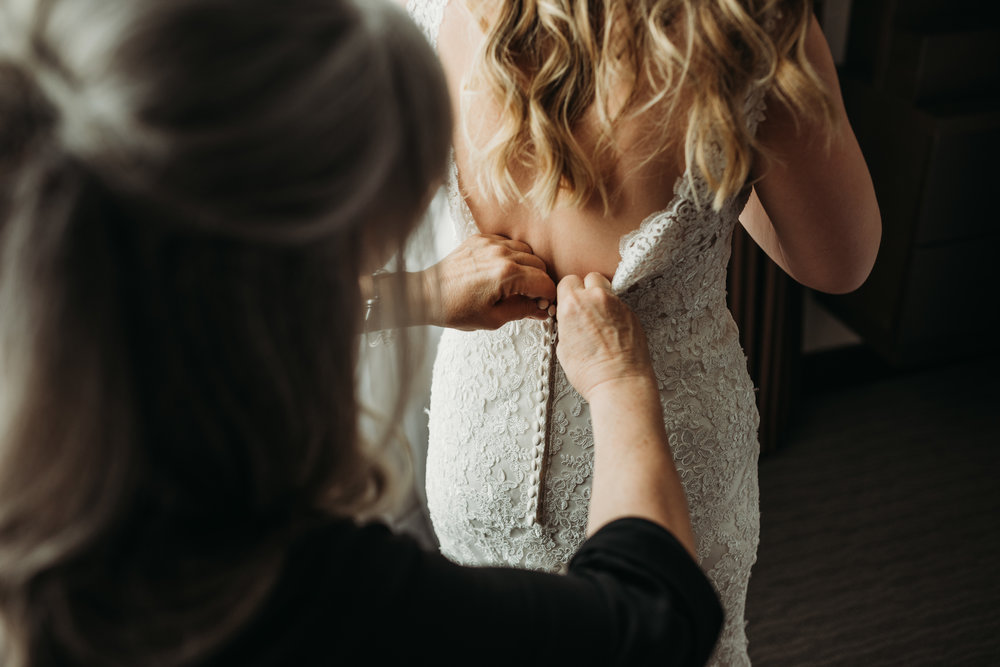 bride-getting-dress-on-getting-ready-pictures-toronto-rustic-boho-airship37-wedding-by-willow-birch-photo-toronto-documentary-wedding-photographers.jpg