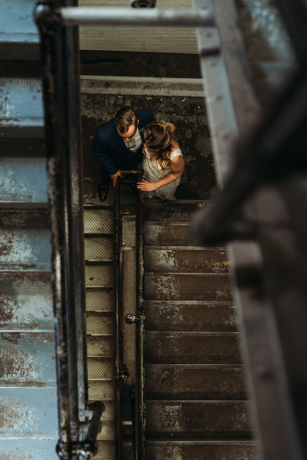 bride-groom-staircase-toronto-rustic-boho-airship37-wedding-by-willow-birch-photo-toronto-documentary-wedding-photographers.jpg
