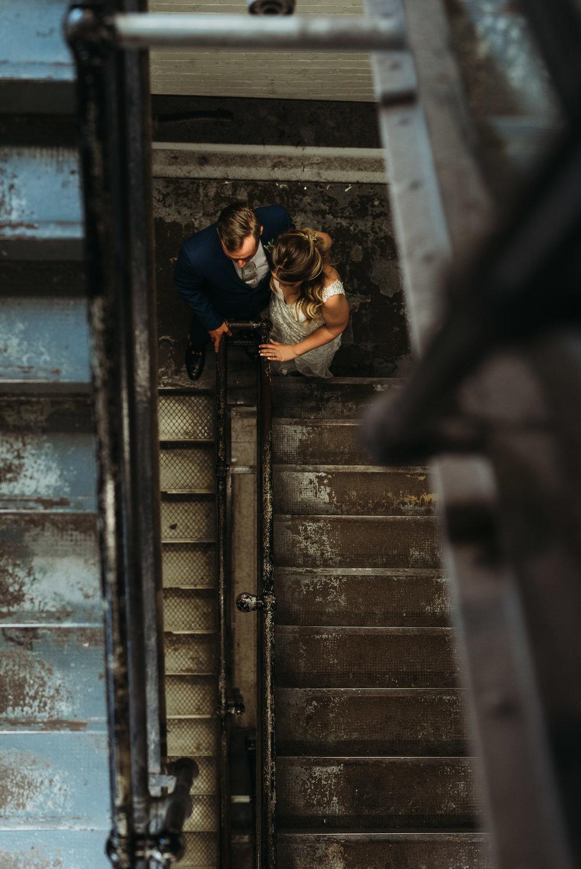 bride-groom-staircase-toronto-rustic-boho-airship37-wedding-by-willow-birch-photo-toronto-documentary-wedding-photographers.jpg