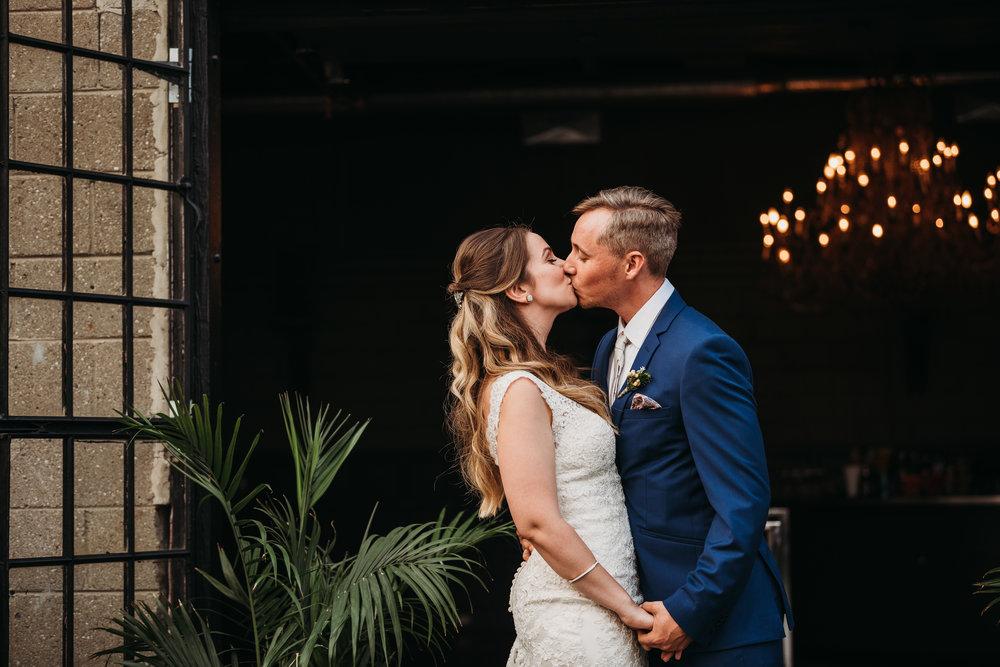 wedding-ceremony-first-kiss-toronto-rustic-boho-airship37-wedding-by-willow-birch-photo-toronto-documentary-wedding-photographers.jpg