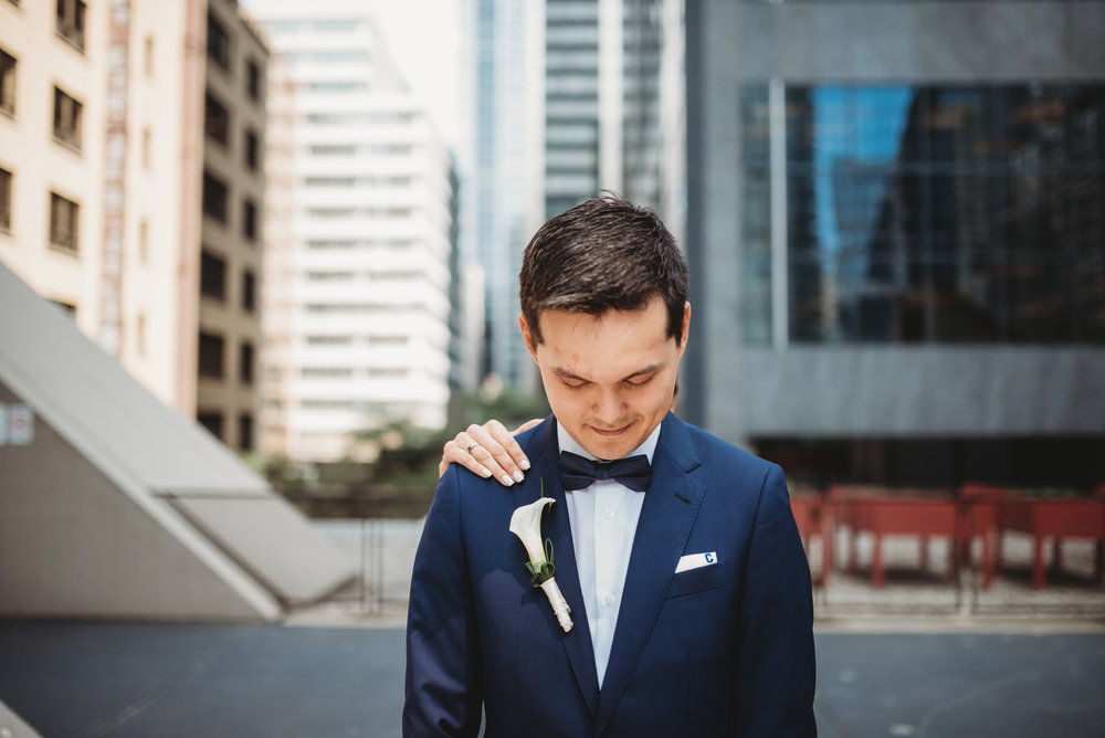 bride-groom-first-look-pictures-hilton-toronto-eglington-grand-wedding-by-willow-birch-photo-toronto-documentary-wedding-photographers.jpg