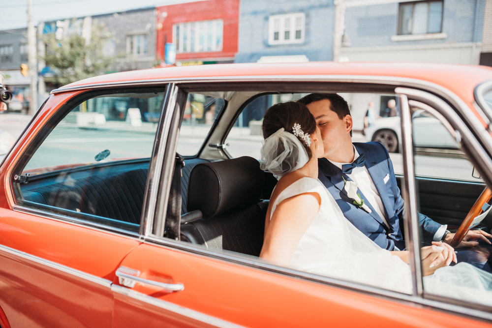 bride-groom-in-restored-cars-eglington-grand-wedding-by-willow-birch-photo-toronto-documentary-wedding-photographers.jpg