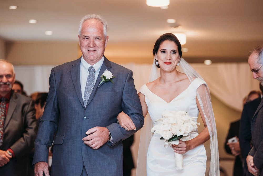 bride-walking-down-aisle-with-father-eglington-grand-wedding-by-willow-birch-photo-toronto-documentary-wedding-photographers.jpg