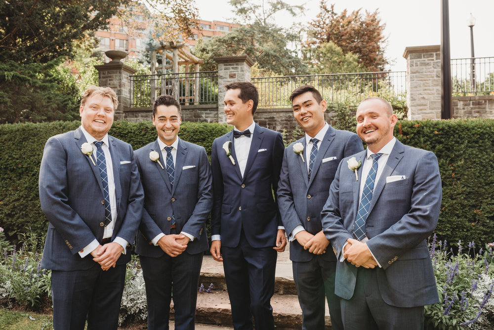 groom-and-groomsman-wedding-party-pictures-eglington-grand-wedding-by-willow-birch-photo-toronto-documentary-wedding-photographers.jpg