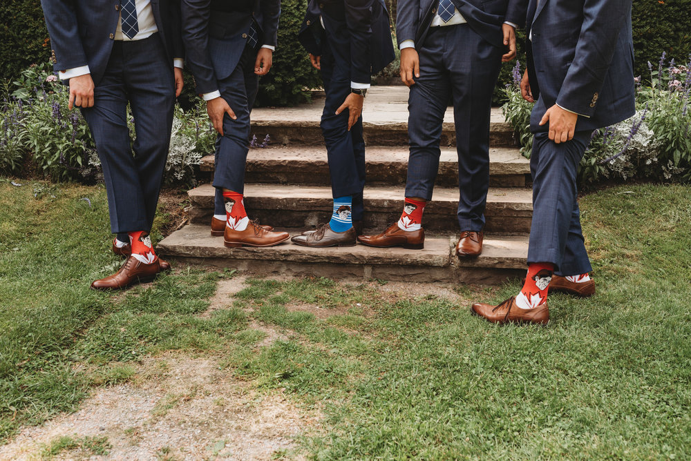 groom-and-groomsmen-socks-wedding-party-pictures-eglington-grand-wedding-by-willow-birch-photo-toronto-documentary-wedding-photographers.jpg