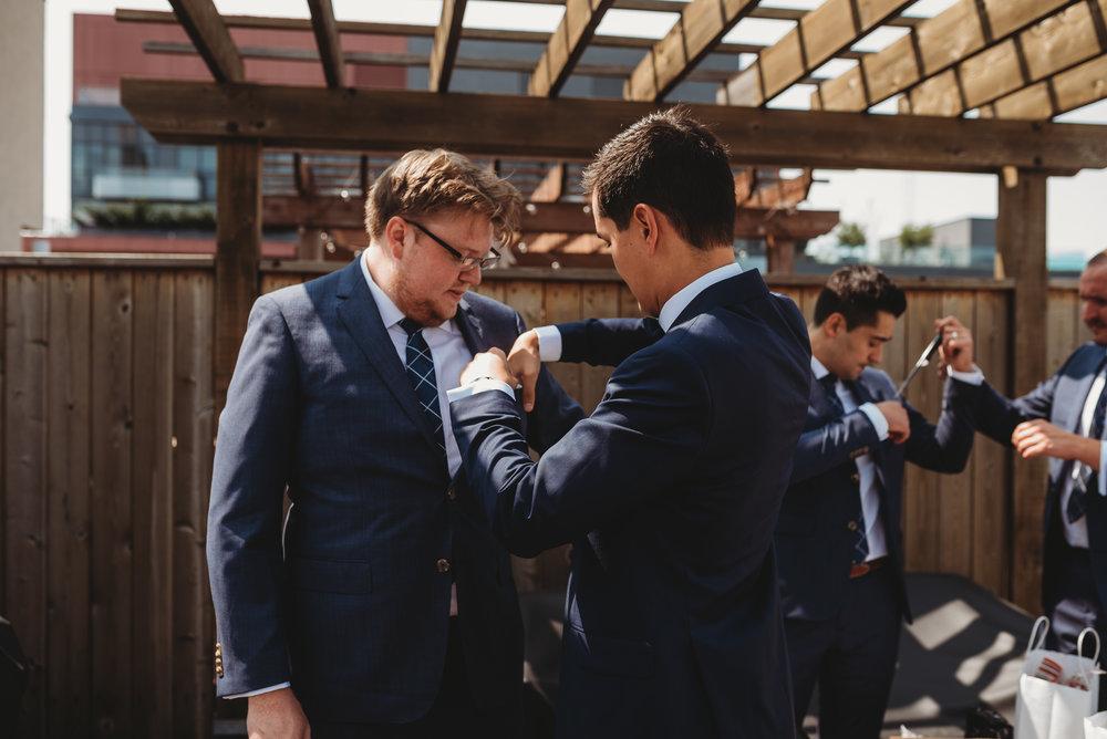 groom-getting-ready-photos-wedding-party-eglington-grand-wedding-by-willow-birch-photo-toronto-documentary-wedding-photographers.jpg