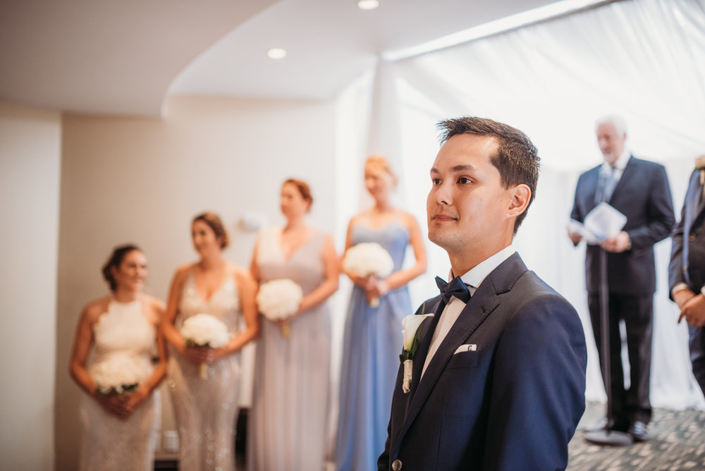 groom-waiting-for-bride-ceremony-eglington-grand-wedding-by-willow-birch-photo-toronto-documentary-wedding-photographers.jpg