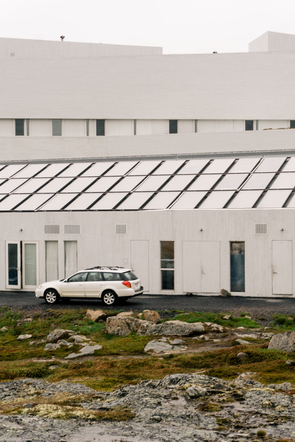 Solar-thermal panels stylishly cover the entirety of one of the buildings.