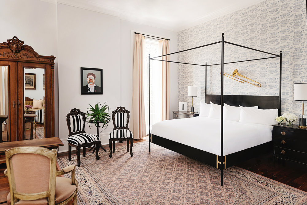 kinG royal gallery - Sculptural King bed with luxurious linens. Relaxing seating area, custom antique furnishings, and a walk-out balcony with 12-foot floor-to-ceiling windows. Fit for Mardi Gras royalty!