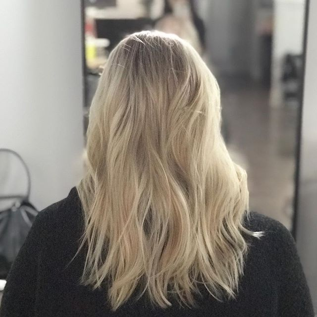 COLOUR CORRECTION 🚨 • This transformation from 6 inches of regrowth and old highlights to this all over blonde bombshell butter blonde took 4.5 hours of patience, careful application, and gentle processing. IT'S WORTH YOUR TIME. Bring snacks, we've got coffee. • . . . . . . #torontohairstylist #torontocolourist #colourcorrection #blondehair #olaplex