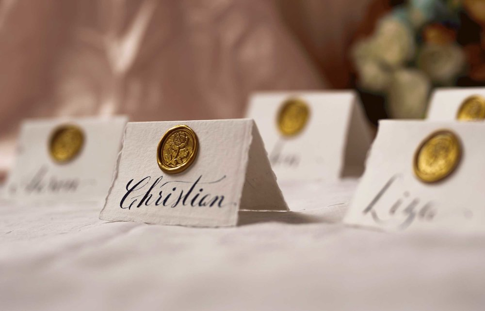 reception event place cards with wax seals