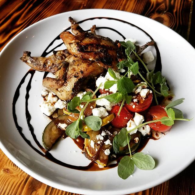 Tonight's Special! Dijon Marinated Quail over charred squash, shallots, and cherry tomatoes with feta, balsamic redux and pea tendrils.