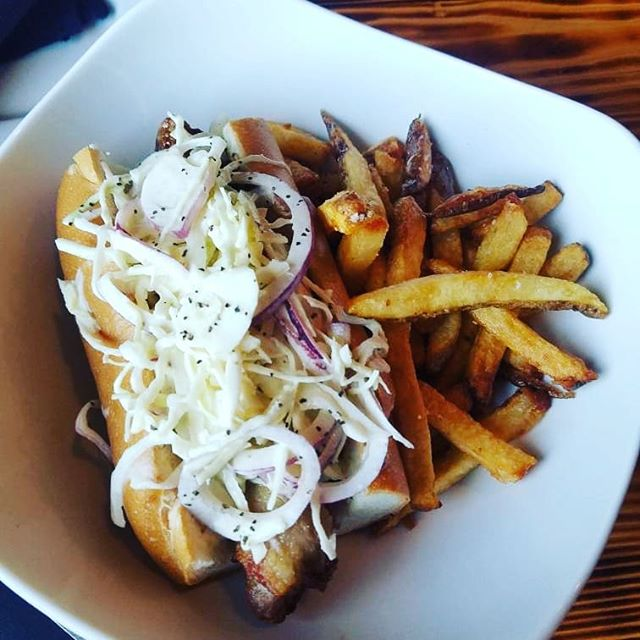 "This is a ""Classic City Dawg."" It's a bratwurst braised in Classic City Lager from @creaturecomfortsbeer wrapped in bacon then deep fried! Topped with slaw & house mustard served with Belgian fries. On special for the weekend!  @craftathens #eatlocal #drinklocal @sobrewco @creaturecomfortsbeer @terrapinbeerco @oconeebbrewingco @mondaynight @orpheusbrewing @redharebrewing #petfriendly #outdoorseating #uga #universityofgeorgia #bulldawgnation #universityofgeorgiabulldawgs #dawgnation #my_athens #athensga #craftbeer #foodie #foodporn #localbrew #housemadepasta #special #pasta #freshmade #athensfoodie #happyhour #sundaybrunch #sundayfunday #fromscratch"