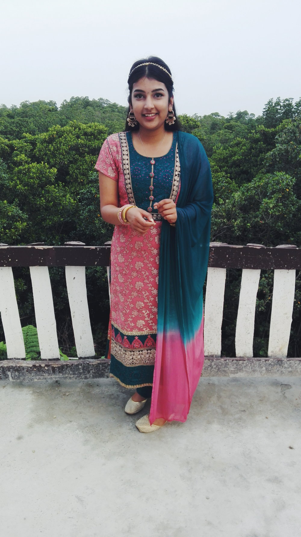 Tilak   A more simpler occasion and a raise from the dead of the straight kameez. Headpiece is actually an anklet and earrings are from Colette (really into mixing indian and western things).