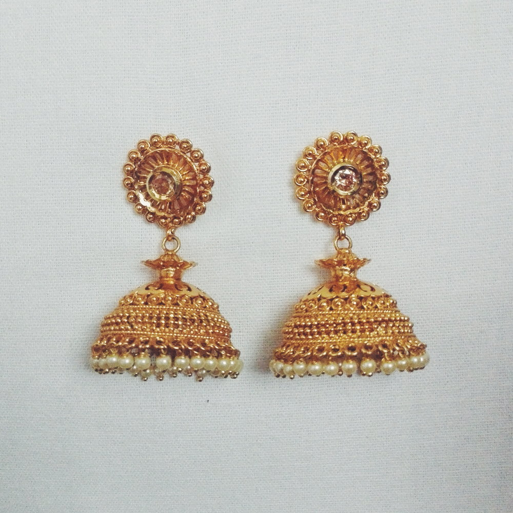 These are a bit new and by far my favourite jhumkas. It's widely popular and just goes with almost every look (definitively everyone need to own a pair of pure jhumkas like these). To see where I've worn this before click  here .