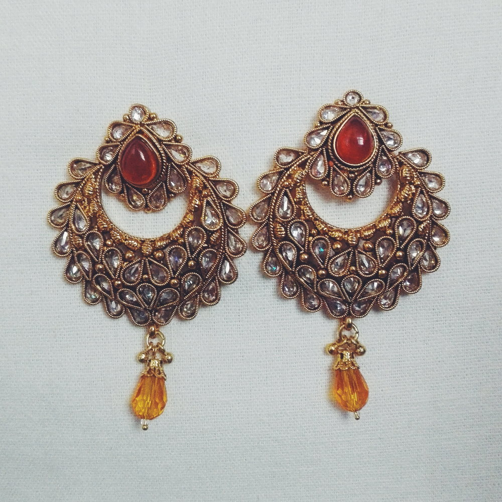 Although Indian fashion (how I interpret it) is moving away from stone work in main stream media, a neat stone work earring is still beautiful to own. I don't have many and this one obviously doesn't go with all colours but it is still beautiful when paired with the right outfit. I see many people will pair stone work earrings with netting clothes which really just makes my sigh, will write a blog post about this later.