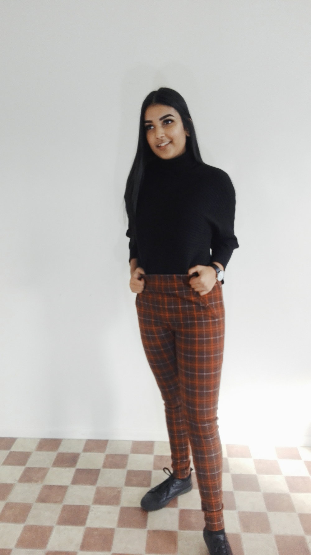 Don't need to hide the turtleneck, it makes a statement of its own. So if you bored with black jeans then switch out the bottoms for something bold like these plaid pants.