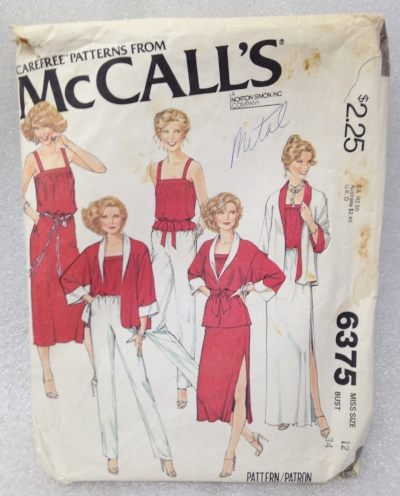 "Record Number: 031 Collection Date: 21 Oct 2017  Description: Brand name clothing pattern, models wearing red and white clothing Dimension: 8"" x 6.25"" x .25"""