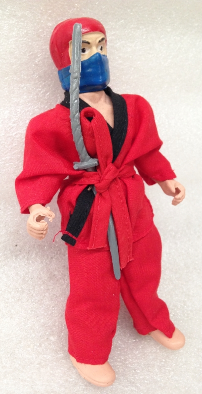 "Record Number: 044 Collection Date: 21 Oct 2017  Description: Toy action figure, red clothes and sword  Dimension: 6.5"" x 3.25"" x 1.5"""