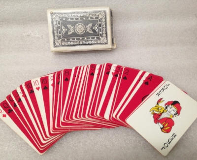 "Record Number: 057 Collection Date: 20 Nov 2017  Description: Sherman's V.T. Playing Cards, 1/2 deck faces intense red Dimension: 3.5"" x 2.5"" x .75"""