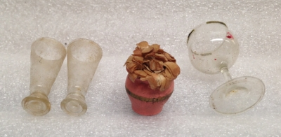 "Record Number: 074 Collection Date: 24 Nov 2017  Description: 3 glasses and a flower pot, clear, aged plastic & pink painted wood Dimension: 1 3/8"" x .5"" (x2), 1"" x .75"", 1.5"" x .75"""