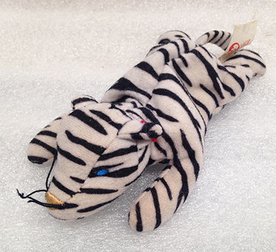 "Record Number: 079 Collection Date: 24 Nov 2017  Description: Stuffed animal #2, black and white stripes Dimension: 3"" x 8"" x 3"""